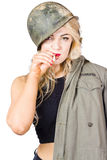 Tough and determined female pin-up soldier smoking Royalty Free Stock Photography