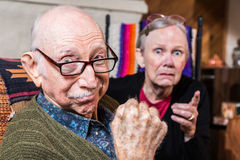 Tough Elderly Couple. Indoors with aggressive gesturing Stock Photo