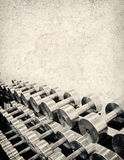 Tough Grunge Weight Training. A tough Weight Training background image with a sepia tone and stone texture. lots of copy space Stock Photo