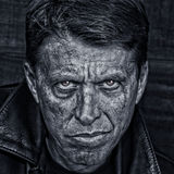 Tough Guy. Rough middle aged man in a leather jacket royalty free stock images