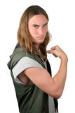 Tough Guy - Bully. A tough looking young man making a muscle.  Isolated Stock Photography