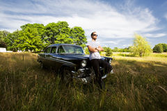 Tough Guy with his Vintage Car Stock Image