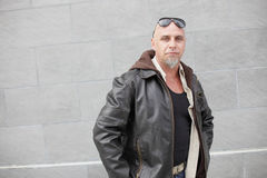 Tough guy with a leather jacket Royalty Free Stock Photography