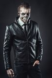 Tough guy leather jacket with the make-up skull Royalty Free Stock Photos