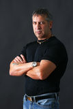 Tough guy looking at camera. Serious or angry tough guy looking at camera Royalty Free Stock Images