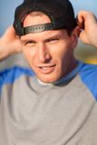Tough guy portrait. Man in a trucker cap. Outdoor shoot Stock Image
