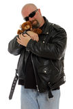 Tough guy with a teddy bear. Tough guy with a leather jacket holding teddy bear Stock Photo