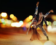 Tough hip hop guy dancing with his girlfriend Stock Photography