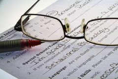 Tough Job Market. Job interview paper with a pen and glasses Royalty Free Stock Image