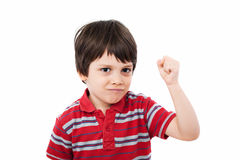 Tough kid. Holding his fist clenched, looking mean Royalty Free Stock Photography