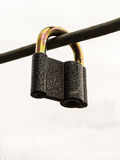 Tough Locked Security Padlock on Iron Rod Stock Photos