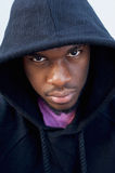 Tough looking black guy with hood sweatshirt Royalty Free Stock Images
