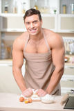 Tough looking guy makes a batch of dough himself Royalty Free Stock Image