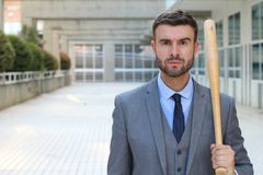 Tough looking male holding baseball bat.  Royalty Free Stock Image