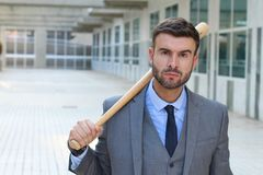 Tough looking male holding baseball bat stock photos