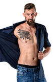 Tough looking man with beard and tattoo isolated on white Royalty Free Stock Photo