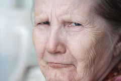 Tough looking old woman Stock Photography