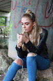 Tough looking teenage girl with her nose pierced smoking Stock Images