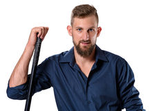Tough looking young man with beard leaning on his hockey racket Stock Photos