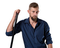 Tough looking young man with beard leaning on his hockey racket Stock Photography