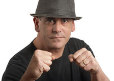 Tough man. Handsome stylish tough man with fists up Royalty Free Stock Photos