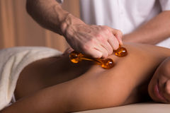 Tough massage with massager Royalty Free Stock Photo