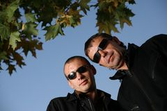 Tough men. Two tough man in sunglasses outdoors Royalty Free Stock Images