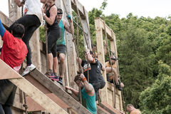 Tough Mudder 2015: Backside Balls. Boughton House, Northamptonshire, UK - May 31, 2015: Tough Mudders on the backside of the Balls to the Walls obstacle at the stock images