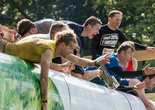 Tough Mudder 2015: Everest 2.0 helping hand Royalty Free Stock Photography