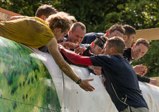 Tough Mudder 2015: Everest 2.0 helping hand Royalty Free Stock Photo