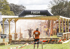 Tough Mudder 2013 Finish Line. Boughton House Northamptonshire/UK -May 4, 2013: Tough Mudder challenge and obstacle course raising funds for Help for Heroes royalty free stock images