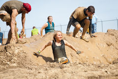 Tough Mudder: Happy Female Racer. A female racer at the Tough Mudder competition in Mansfield Ohio on April 27, 2013. This race was designed by British Special stock images