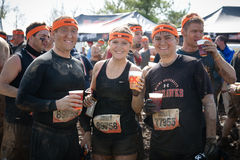Tough Mudder: Happy Race Finishers. Racers proudly wearing their headbands and drinking XX beer after the Tough Mudder competition in Mansfield Ohio on April 27 stock image
