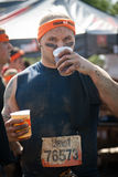 Tough Mudder: Happy Runner After the Race. Racer proudly wearing his headband and drinking XX beer after the Tough Mudder competition in Mansfield Ohio on April royalty free stock images