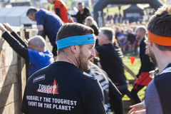 Tough mudder 2015 London South. HAMPSHIRE, UK - SEPTEMBER 26, 2015: Tough Mudder is a team-oriented 18-20 km obstacle course testing strength and mental grit. It stock photography