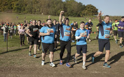 Tough mudder 2015 London South. HAMPSHIRE, UK - SEPTEMBER 26, 2015: Tough Mudder is a team-oriented 18-20 km obstacle course testing strength and mental grit. It royalty free stock photos