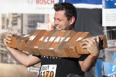 Tough mudder 2015 London South. HAMPSHIRE, UK - SEPTEMBER 26, 2015: Tough Mudder is a team-oriented 18-20 km obstacle course testing strength and mental grit. It stock images
