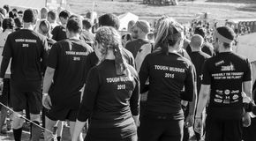 Tough Mudder 2015 London South UK. HAMPSHIRE, UK - SEPTEMBER 26, 2015: Tough Mudder is a team-oriented 18-20 km obstacle course testing strength and mental grit stock images