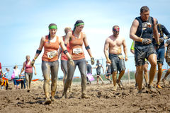 Tough Mudder: Muddy Team of Racers Royalty Free Stock Photos