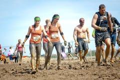 Tough Mudder: Muddy Team of Racers Royalty Free Stock Photos