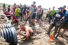 Tough Mudder: Racers Entering the Boa Constrictor. Male and female racers entering the boa constrictor obstacle at the Tough Mudder competition in Mansfield Ohio royalty free stock images