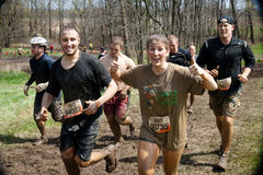 Tough Mudder: Racers Having Fun Getting Muddy. Group of Racers running between obsticles at the Tough Mudder competition in Mansfield Ohio on April 27, 2013 Royalty Free Stock Photo
