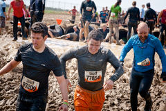 Tough Mudder: Racers Having Fun. Group of Racers running between obsticles at the Tough Mudder competition in Mansfield Ohio on April 27, 2013. This race was stock images