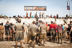 Tough Mudder: Racers Waiting at the Everest Obstic. Teams of Racers waiting for their turn to try go through the Everest Obsticle at the Tough Mudder competition Royalty Free Stock Images
