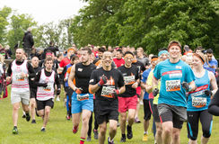 Tough Mudder 2015: Starting Line Wave. Boughton House, Northamptonshire, UK - May 31, 2015: A wave of Tough Mudders leave the start line en route to their first stock image