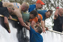 Tough Mudders Climbing Everest Royalty Free Stock Image