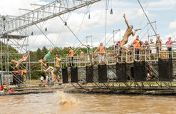 Tough Muddger 2015: Reach for the bell Royalty Free Stock Photos