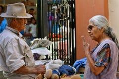 Tough negotiation at mexican market. Vendors at a mexican market negotiating tenaciously Royalty Free Stock Photo