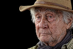 Tough old rancher isolated on black Royalty Free Stock Photography