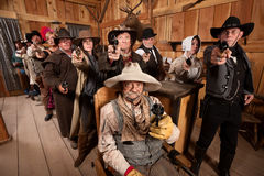 Tough People with Guns in Old Saloon Royalty Free Stock Photo